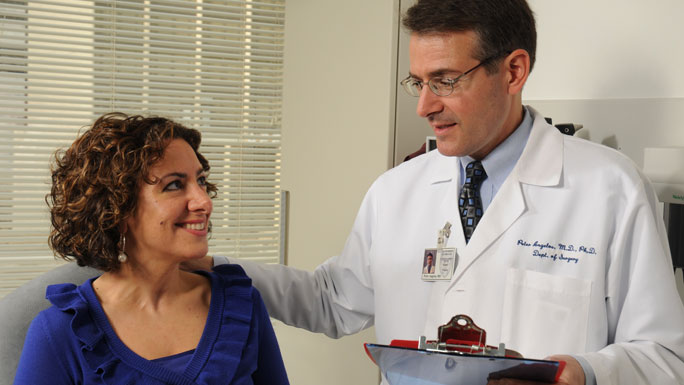 Peter Angelos, MD, with female patient