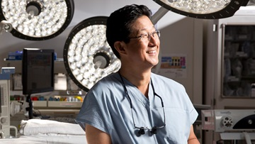 David Chang, MD, lymphedema surgery expert, portrait in surgical suite
