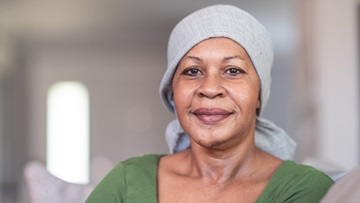 female Black cancer patient wearing headscarf