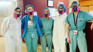 Valerie Press, MD, MPH, Associate Professor of Medicine and residents Alexandra Rojek, MD, Jori Sheade, MD, Albina Tyker, MD, and Kevin Prescott, MD pose for a photo in personal protective equipment.