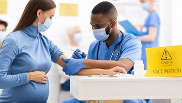 pregnant woman getting COVID-19 vaccine