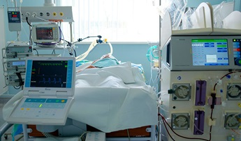 Emergency patient in critical state with intraaortic balloon pump and extracorporeal circuit hemodialysis assist.
