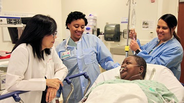Karen KIm, MD, and her patient before colonoscopy procedure