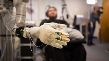 Patient with robotic hand