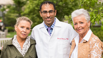 Debby Thompson, medical oncologists Manish Sharma, MD, and Margaret Harrigan