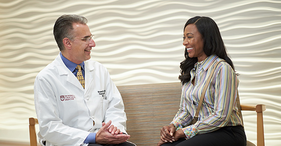 Russell Cohen, MD, talks with an IBD patient about treatment options