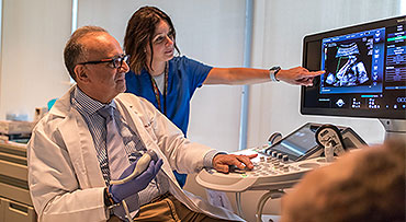 Obstetric ultrasound expert Jacques Abrowicz, MD, and nurse reviewing an image