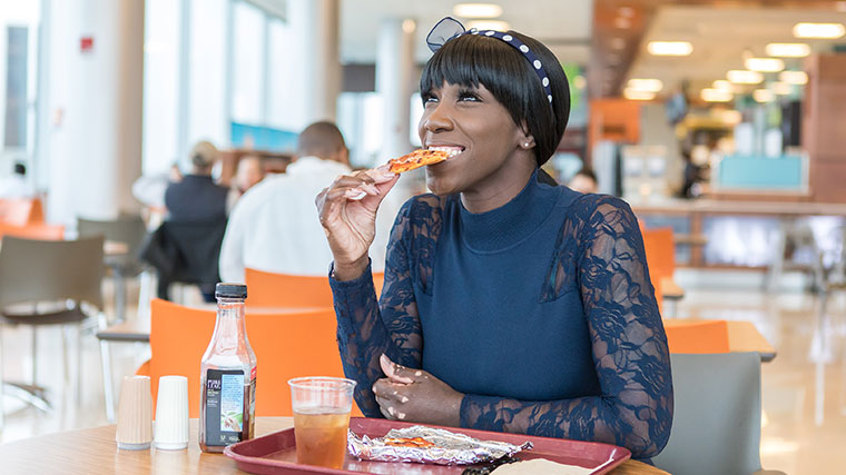 Dorian Brantley, University of Chicago patient and UChicago Medicine nurse, eating pizza again after her achalasia surgery