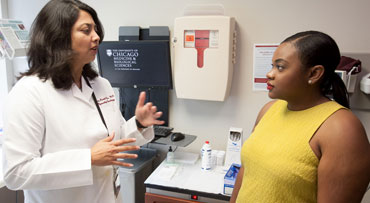 Nita Lee, MD, talking with patient