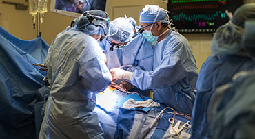 Dr. Talia Baker and Dr. John Fung in liver transplant surgery